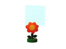 Flor y papel de nota anaranjados Foto de archivo