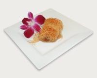 Flor y pasteles Imágenes de archivo libres de regalías