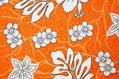 Flora pattern on orange color fabric Stock Image