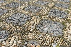 Flora Stone Pavement. Flora pebble and stone flooring Stock Photography