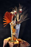 Floral. Composition of flowers in wood and Iin crystal vase on a black background Stock Photo