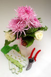Floral arrangement. A pink floral arrangement with tools and gloves Royalty Free Stock Photos
