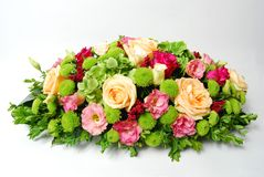 Floral arrangement. For wedding with: yelow and pink roses, green chrysanthemum and green hortensia Royalty Free Stock Images