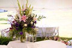 Floral arrangement. Outdoor wedding flower arrangement royalty free stock photography