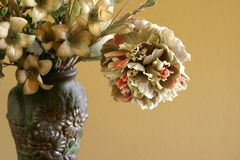 Floral arrangement. Silk floral arrangement against beige background stock images