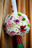 Floral arrangement on a baptismal candle Royalty Free Stock Images