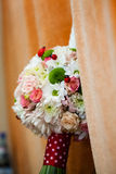 Floral arrangement on a baptismal candle Stock Images