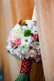 Floral arrangement on a baptismal candle Stock Photography