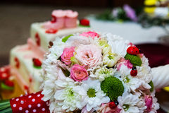 Floral arrangement on a baptismal candle Royalty Free Stock Image