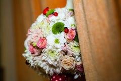 Floral arrangement on a baptismal candle Stock Image