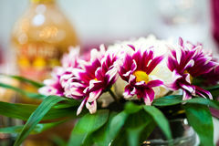 Floral arrangement at a baptismal party Royalty Free Stock Images
