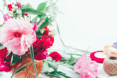 Floral arrangement from beautiful bouquet of pink flowers peons, cornflowers and red roses on white background with space for tex Royalty Free Stock Photos