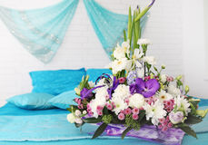 Floral arrangement on the bed Stock Photography
