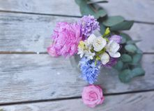 Floral arrangement on the board Stock Photos