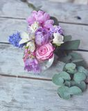 Floral arrangement on the board Stock Images