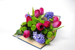 Floral arrangement in a book. Floral arrangement with tulips and hyacinth in a book Royalty Free Stock Photography