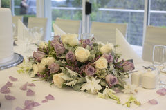 Floral arrangement on bridal table Stock Images