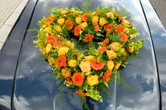 Floral arrangement on car Royalty Free Stock Photos