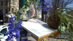 Floral arrangement in the center of the bustling city. HELSINKI, FINLAND - MAY 20, 2017: Floral arrangement in the center of the bustling city stock video