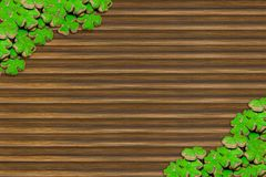 Floral arrangement clover spring holiday irish day saint patricks on a ribbed wooden surface with ornamentation in the corners royalty free stock photo