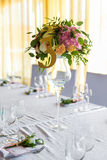 Floral arrangement for decoration wedding table for guests. Room Stock Images