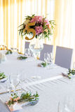 Floral arrangement for decoration wedding table for guests. Room Royalty Free Stock Photo