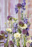 Floral arrangement with delphinium and gerbera flowers Stock Photos