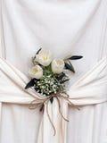 Floral arrangement in draped fabric. Interior design, arrangement. Royalty Free Stock Photo