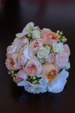 Vertical shot of glamorous wedding bouquet featuring peonies and roses. Floral arrangement, essential accessory for the bride, details, ideas, concepts for bride Stock Photos