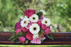 Gerbera, peonies and pink roses in a large wedding bridal arrangement, with blurred background. Floral arrangement, essential accessory for the bride, details Stock Photo