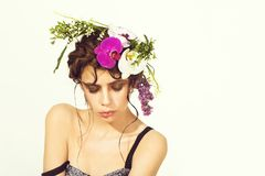 Floral arrangement. floral hairstyle. girl with stylish makeup and natural flowers in hair. Floral arrangement. floral hairstyle. girl, with stylish makeup on Royalty Free Stock Photography