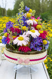 Floral arrangement with gerbera flower and delphinium. Stock Photo
