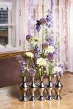 Floral arrangement in modern silver vase Stock Photography