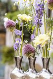 Floral arrangement in modern silver vase Royalty Free Stock Photo