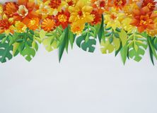 Floral arrangement of paper flowers on a white background.The view from the top. Floral arrangement of paper flowers on a blue background. tropical flowers and Stock Photos