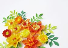 Floral arrangement of paper flowers on a white background.The view from the top. Floral arrangement of paper flowers on a blue background. tropical flowers and Stock Photo