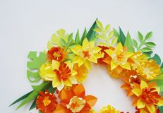 Floral arrangement of paper flowers on a white background.The view from the top. Floral arrangement of paper flowers on a blue background. tropical flowers and Stock Images