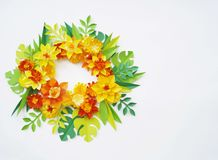Floral arrangement of paper flowers on a white background.The view from the top. Floral arrangement of paper flowers on a blue background. tropical flowers and Stock Image
