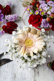 Floral arrangement with peach gerbera flower and gypsophila paniculata