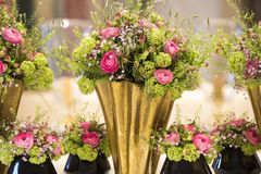Extraordinary floral arrangement with pink buttercups, guelder roses Royalty Free Stock Image