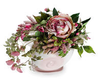 Floral arrangement in a pink ceramic vase Royalty Free Stock Photos