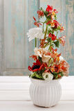 Floral arrangement with ranunculus, orchid and carnation flowers Stock Images