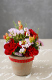 Floral arrangement with red carnations and hypericum seeds Stock Images