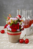 Floral arrangement with red carnations and hypericum seeds Royalty Free Stock Photography
