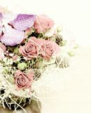 Floral arrangement of roses and orchid Royalty Free Stock Photo