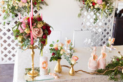 Floral arrangement to decorate the wedding feast, the bride and Stock Photography