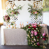 Floral arrangement to decorate the wedding feast, the bride and Stock Image