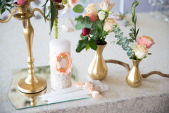 Floral arrangement to decorate the wedding feast, the bride and Royalty Free Stock Images