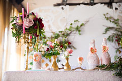 Floral arrangement to decorate the wedding feast, the bride and Royalty Free Stock Image