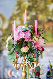 Floral arrangement to decorate the wedding feast, the bride and Stock Photos